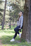 Young pretty girl doing exercise and running in the park. Beautiful young woman is resting during exercise in the park. Selective focus and small depth of field Royalty Free Stock Photography
