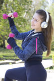 Young pretty girl doing exercise and running in the park Royalty Free Stock Images
