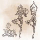 Young pretty girl doing yoga. Vrikshasana: tree posture, Hand dr Royalty Free Stock Photography