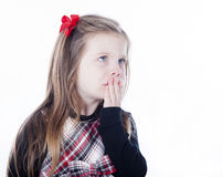 Young pretty girl in a dress on white background. With her mouth covered Royalty Free Stock Photography