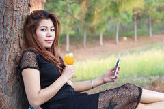 Young pretty girl drinking orange juice and Young female profess Royalty Free Stock Images