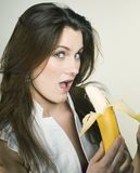 Young Pretty Girl Eating Banana, Lifestyle People Concept Royalty Free Stock Photography
