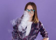 Young pretty girl with electronic cigarette. Vaping girl background cigarette woman young electronic vape stock image