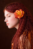 Young pretty girl with a flower Royalty Free Stock Photography
