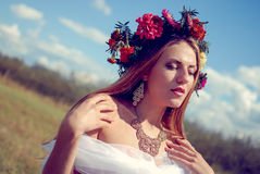 Young pretty girl in flower wreath and ethnic Royalty Free Stock Image