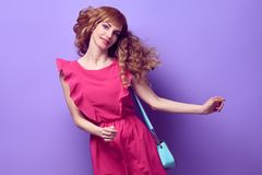 Fashion. Happy Girl Smiling dance in Studio royalty free stock photography