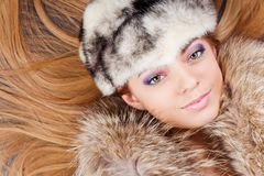 Young pretty girl in fur hat Royalty Free Stock Images