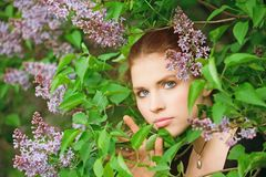 Young pretty girl in the garden Royalty Free Stock Images