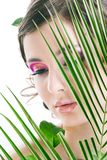 Young pretty girl with green leaf Stock Images