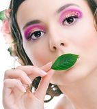 Young pretty girl with green leaf Royalty Free Stock Photography