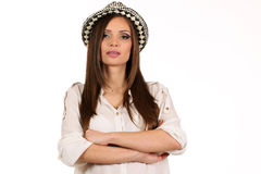 Young pretty girl with a hat on her head isolated on white studio shot Royalty Free Stock Photos