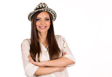 Young pretty girl with a hat on her head isolated on white studio shot Royalty Free Stock Images