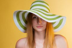 Young pretty girl with a hat on her head Stock Photo