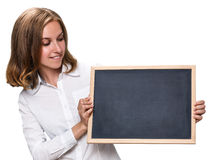 Young pretty girl holding chalkboard stock image