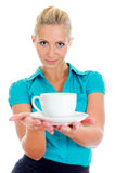 Young pretty girl holding cup of tea. Royalty Free Stock Photos