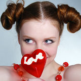Young pretty girl holding a lollipop Stock Photography