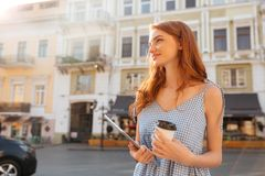 Young pretty girl holding pc tablet and cup of coffee Royalty Free Stock Photography