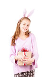 Young pretty girl with holiday gift in hands isolated Stock Images