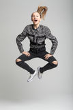 Young pretty girl jumping high Royalty Free Stock Image