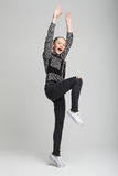 Young pretty girl jumping and screaming Royalty Free Stock Image