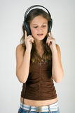 Young pretty girl listening music with headphones Royalty Free Stock Photos