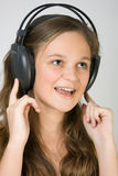 Young pretty girl listening music with headphones Royalty Free Stock Photo