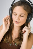 Young pretty girl listening music with headphones Stock Image