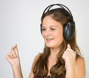 Young pretty girl listening music with headphones Stock Photos