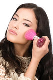 Young pretty girl makeup with powder brush Stock Photography