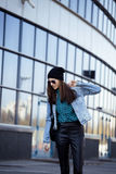 Young pretty girl near business building Royalty Free Stock Images