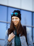 Young pretty girl near business building. Walking Stock Photography