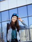 Young pretty girl near business building walking Stock Photography
