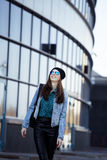 Young pretty girl near business building walking Stock Images