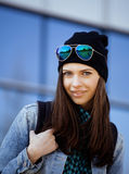 Young pretty girl near business building walking Royalty Free Stock Photo