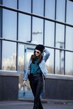 Young pretty girl near business building walking Royalty Free Stock Images