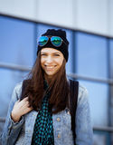 Young pretty girl near business building walking Royalty Free Stock Photography