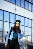 Young pretty girl near business building walking Stock Photo