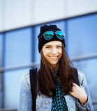 Young pretty girl near business building walking. Student teenager on blue Stock Photos