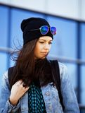 Young pretty girl near business building walking. Student teenager on blue Stock Image