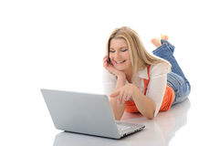 Young pretty girl networking on laptop computer Royalty Free Stock Image