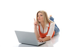 Young pretty girl networking on laptop computer Stock Photography