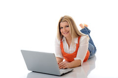 Young pretty girl networking on laptop computer. In internet. isolated on white background stock photos