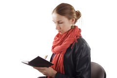 Young pretty girl with an open notebook and pen Stock Images