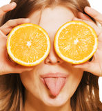 Young pretty girl with orange close up Royalty Free Stock Photo