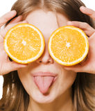 Young pretty girl with orange close up Royalty Free Stock Photography