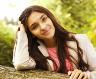 Young pretty girl in park Stock Images