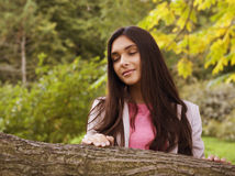 Young pretty girl in park Royalty Free Stock Image