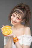 Young pretty girl portrait. Portrait of young pretty girl with oranges in her hands Stock Images
