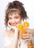 Young pretty girl portrait. Young pretty girl with glass of orange juice Stock Images