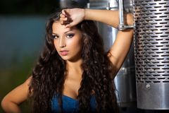 Young pretty girl portrait near steel truck Royalty Free Stock Photos